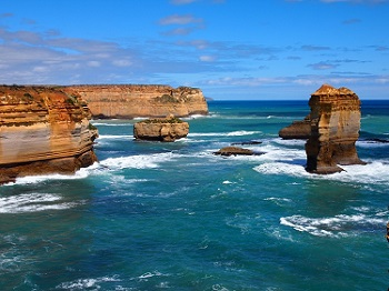 The Twelve Apostles rock formation can be see while driving along Great Ocean Road in Australia.